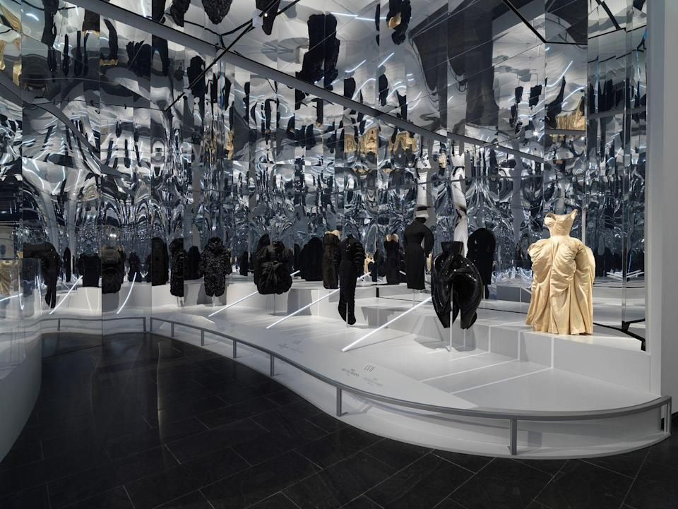 <p>Far right: a 2012 Iris van Herpen dress and 1951 Charles James ball gown. </p>