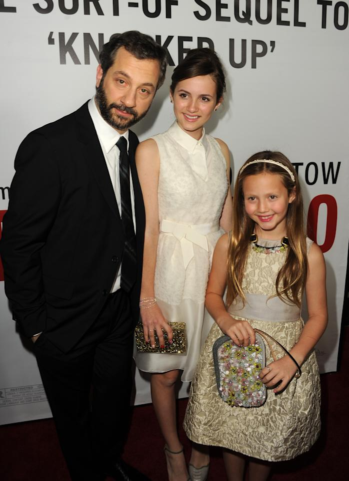 "HOLLYWOOD, CA - DECEMBER 12:  Director Judd Apatow, actress Maude Apatow and actress Iris Apatow attend the premiere of Universal Pictures' ""This Is 40"" at Grauman's Chinese Theatre on December 12, 2012 in Hollywood, California.  (Photo by Kevin Winter/Getty Images)"