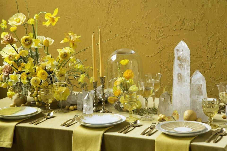 """<p>A winter wedding means you're likely decorating indoors for an intimate group, with COVID-19 regulations in mind. For a fresh take on what will likely be a dinner party for the ages, focus on a more monochromatic color scheme. Colors like goldenrod, mustard, ochre, and honey may seem summery to some, but for <a href=""""https://putnamflowers.com/"""" rel=""""nofollow noopener"""" target=""""_blank"""" data-ylk=""""slk:BAZAAR Bride Top Florist Putnam & Putnam"""" class=""""link rapid-noclick-resp"""">BAZAAR Bride Top Florist Putnam & Putnam</a>, it brings the sunlit shades of the west coast into winter; think: jewel tones of citrine, amber fireplaces, and mustard seeds planted up and down the California coastline. </p><p>Consider applying this idea to your favorite shade, be it soft blues, winter whites and neutrals, or a deep shade like burgundy, emerald, or eggplant. </p>"""