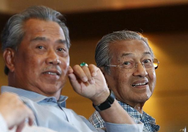 Former deputy prime minister Tan Sri Muhyiddin Yassin (left) and former prime minister Tun Dr Mahathir Mohamad during the Kongress Rakyat 2016 forum organised by the Save Malaysia movement in Shah Alam March 27, 2016. — Reuters pic