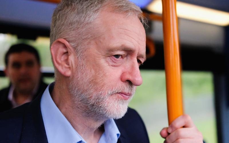 Jeremy Corbyn on a bus - Credit: Getty