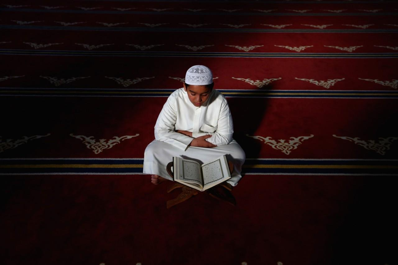 <p>A young Emirati boy reads the Quran during the holy month of Ramadan at Al Farooq Mosque in Dubai, June 8, 2016. (François Nel/Getty Images) </p>