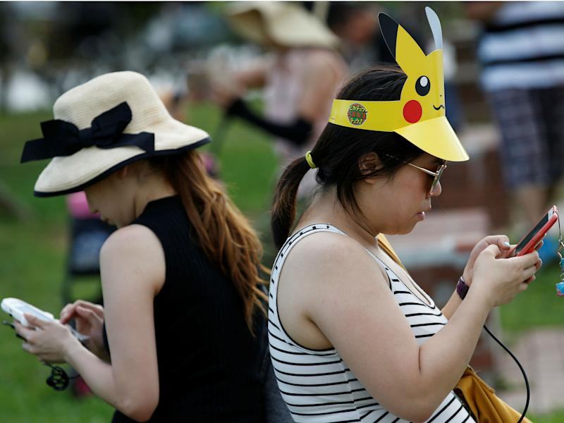 Women play Pokemon Go at an event in Yokohama, Japan August 9, 2017: REUTERS/Kim Kyung-Hoon
