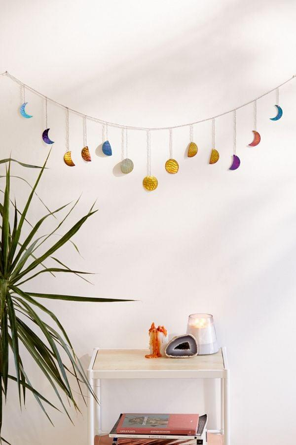 """<p>This <a href=""""https://www.popsugar.com/buy/Hammered-Metal-Moon-Cycle-Banner-498856?p_name=Hammered%20Metal%20Moon%20Cycle%20Banner&retailer=urbanoutfitters.com&pid=498856&price=18&evar1=savvy%3Aus&evar9=46725265&evar98=https%3A%2F%2Fwww.popsugar.com%2Fphoto-gallery%2F46725265%2Fimage%2F46725642%2FHammered-Metal-Moon-Cycle-Banner&list1=shopping%2Cgifts%2Curban%20outfitters%2Cgift%20guide%2Cgifts%20under%20%2425&prop13=api&pdata=1"""" rel=""""nofollow"""" data-shoppable-link=""""1"""" target=""""_blank"""" class=""""ga-track"""" data-ga-category=""""Related"""" data-ga-label=""""https://www.urbanoutfitters.com/shop/hammered-metal-moon-cycle-banner?category=home&amp;color=095&amp;quantity=1&amp;size=ONE%20SIZE&amp;type=REGULAR"""" data-ga-action=""""In-Line Links"""">Hammered Metal Moon Cycle Banner</a> ($18) will add the dreamiest detail to any space.</p>"""
