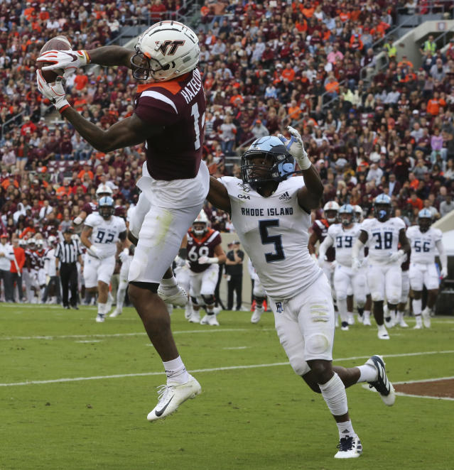 Virginia Tech receiver Damon Hazelton (14) cannot hold on to a pass in the endzone while defended by Rhode Island's Malik Wilder (5) in the first half of an NCAA college football game in Blacksburg Va., Saturday, Oct. 12 2019. (Matt Gentry/The Roanoke Times via AP)