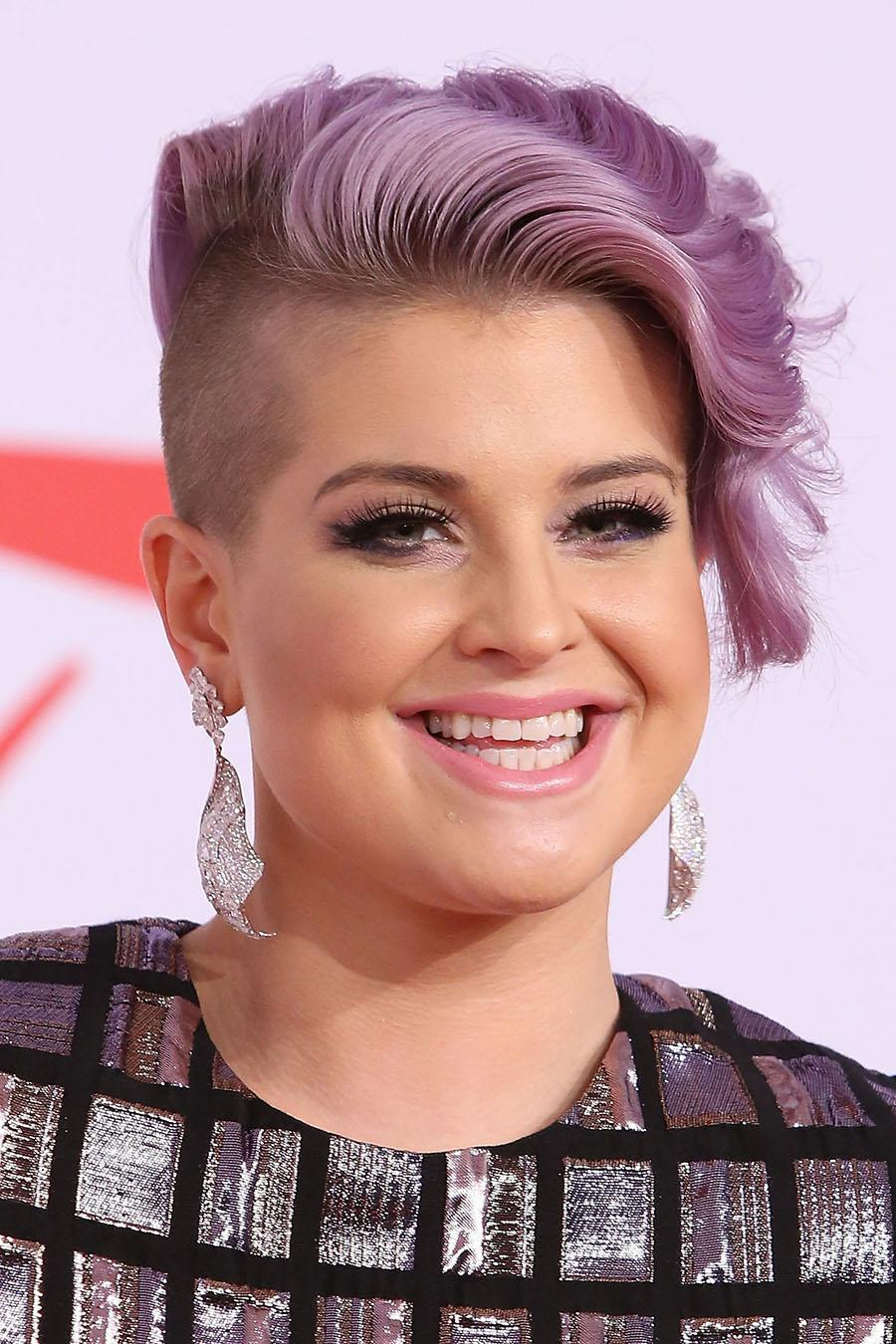 <p>Osbourne is another huge fan of purple hair, and this half-shaved look gives it a funky spin. (Photo: Getty Images) </p>
