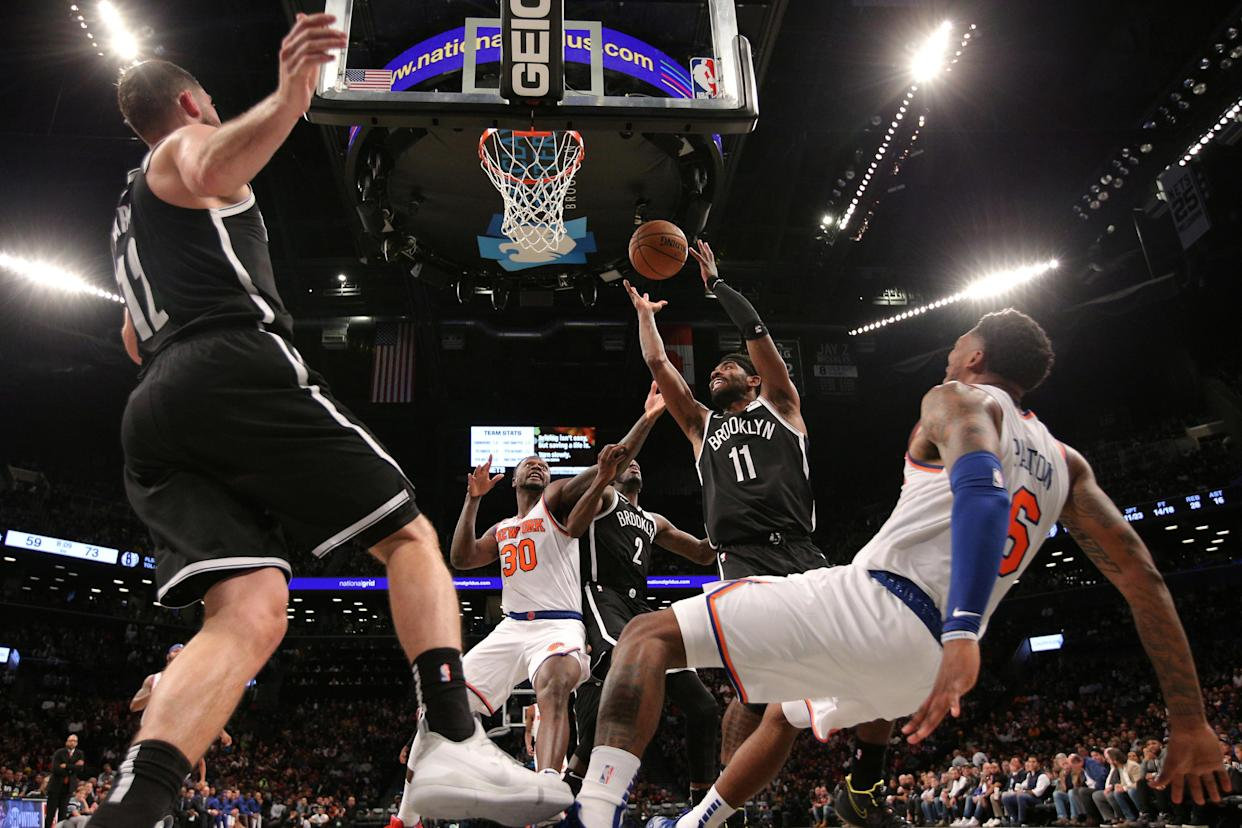 Oct 25, 2019; Brooklyn, NY, USA; Brooklyn Nets point guard Kyrie Irving (11) grabs a rebound against the New York Knicks during the third quarter at Barclays Center. Mandatory Credit: Brad Penner-USA TODAY Sports     TPX IMAGES OF THE DAY