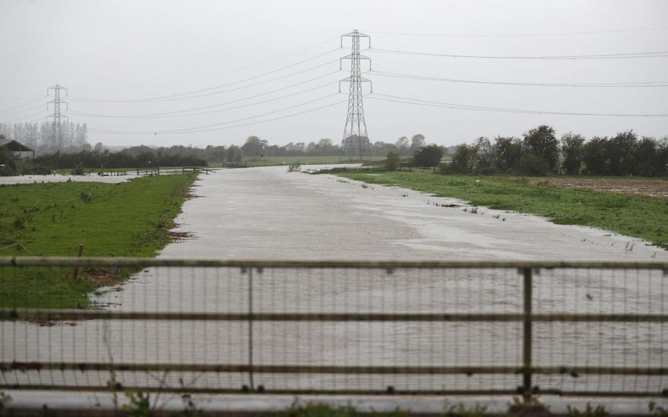 A flooded River Brue near to Westhay in Somerset. The UK's wet weekend will continue as a weather warning for rain across parts of Wales and England has been extended - Andrew Matthews/PA