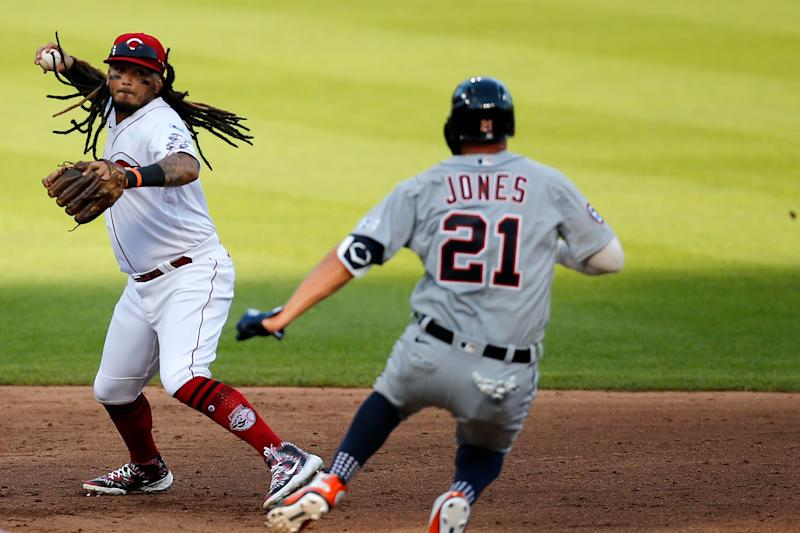 Reds shortstop Freddy Galvis tags second before throwing over Tigers center fielder JaCoby Jones to complete a double play on a ground ball off the bat of shortstop Niko Goodrum in the third inning at Great American Ball Park in Cincinnati on Friday, July 24, 2020.