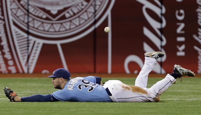 Tampa Bay Rays center fielder Kevin Kiermaier dives but cannot come up with a double by Boston Red Sox's Mookie Betts during the eighth inning of a baseball game Sunday, Aug. 31, 2014, in St. Petersburg, Fla. (AP Photo/Chris O'Meara)