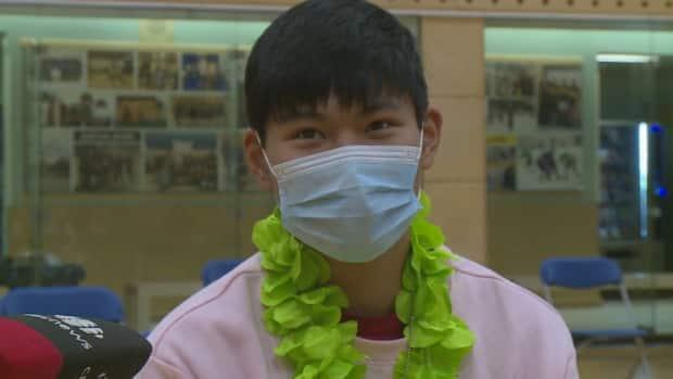 Sixteen-year-old Liam But was one of dozens of students at Sir John Franklin High School to receive a vaccine Wednesday.