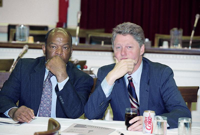 Rep. John Lewis, D-Ga., reflects with Democratic presidential candidate Bill Clinton during a meeting of the Congressional Black Caucus in Capitol Hill on July 1, 1992. (Doug Mills/AP)