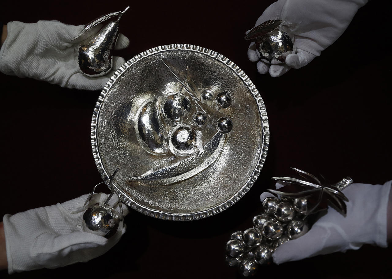 <p>A silver bowl containing fruits grown in Zambia modelled in silver, which were presented by Zambian President Kenneth Kaunda, are on display at Buckingham Palace in London, Monday, April 3, 2017. A selection of objects from Royal Gifts will be on display as part of the Summer Opening of the State Rooms at Buckingham Palace on July 22, 2017. (Frank Augstein/AP) </p>