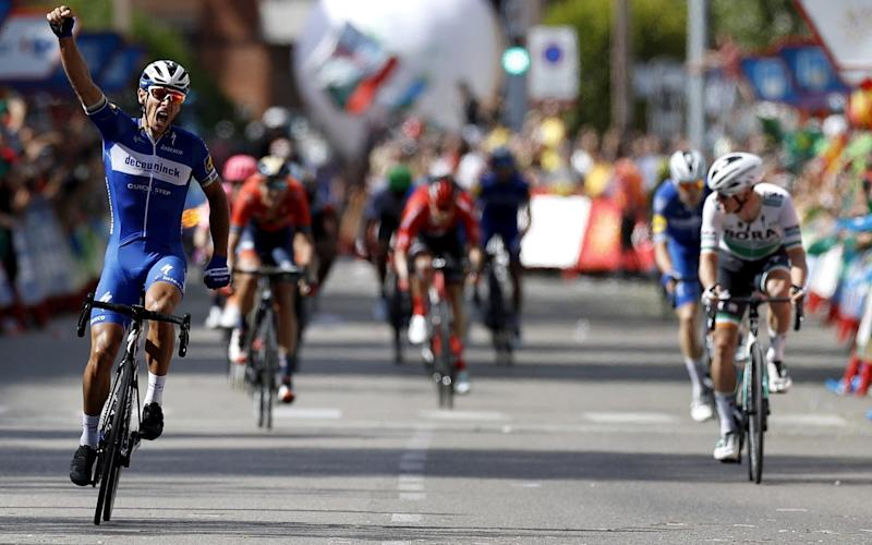 Philippe Gilbert punches the air in celebration as he crosses the line to win stage 17 at theVuelta a España - EPA