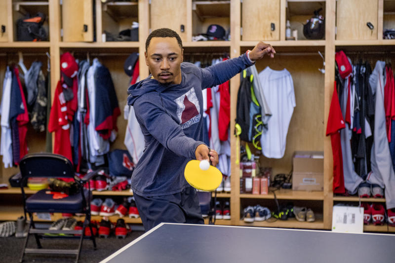 FT. MYERS, FL - MARCH 8: Mookie Betts #50 of the Boston Red Sox plays ping pong in the clubhouse before a team workout on March 8, 2017 at Fenway South in Fort Myers, Florida . (Photo by Billie Weiss/Boston Red Sox/Getty Images)