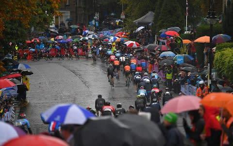 <span>The fans turned out in their hundreds despite the poor weather</span> <span>Credit: Getty Images </span>