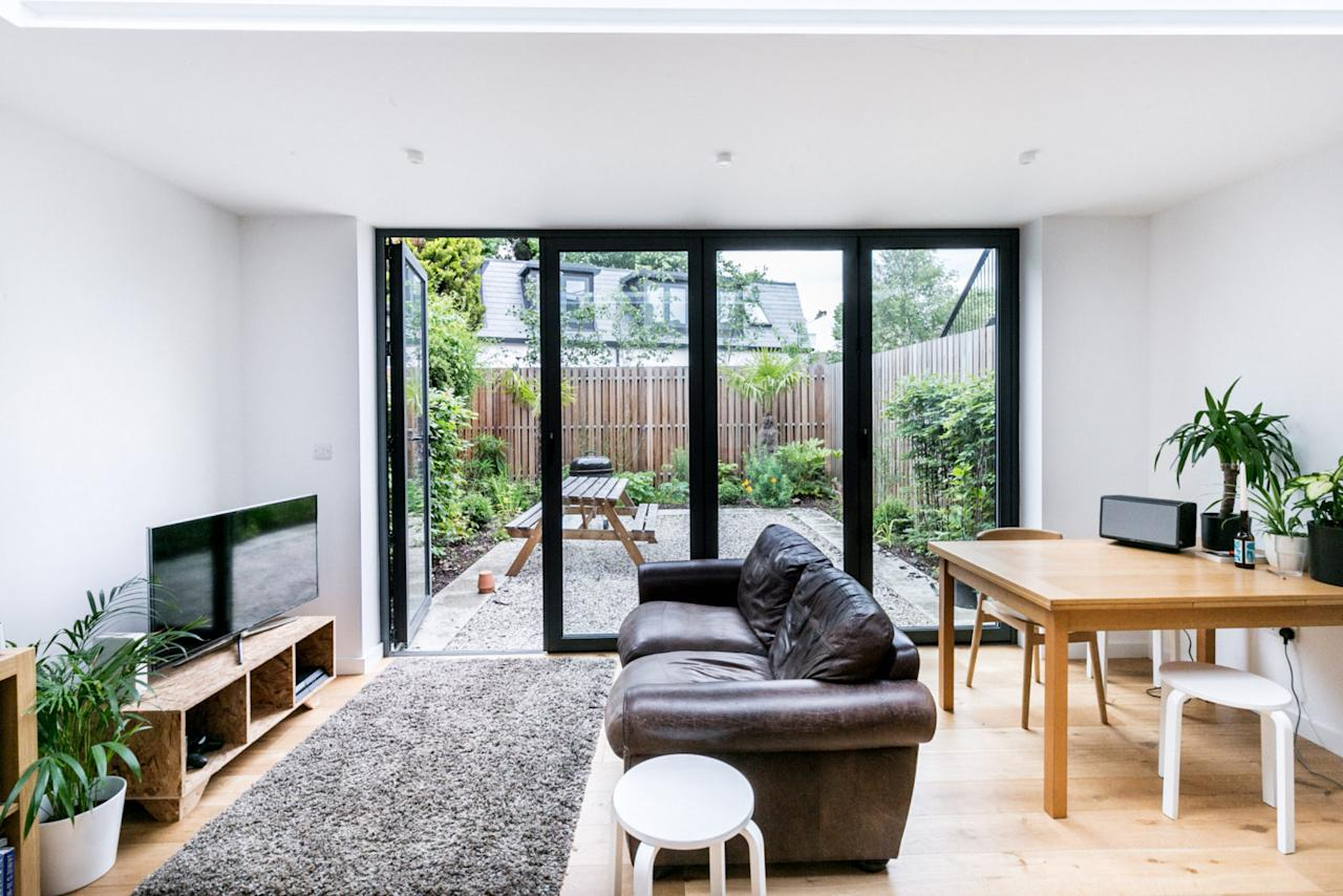 <p>The open living room spans the width of the house and gives access to the garden through glazed doors. </p>