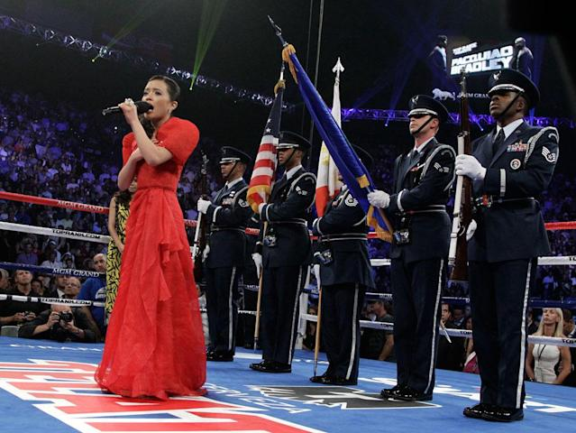 Kirby Asunto sings the Philippine national anthem before the WBO welterweight title fight between Manny Pacquiao, from the Philippines, and Timothy Bradley, from Palm Springs, Calif., Saturday, June 9, 2012, in Las Vegas.