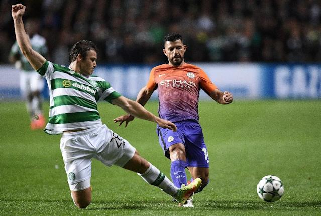 Celtic's Danish defender Erik Sviatchenko (L) tackles Manchester City's Argentinian striker Sergio Aguero during the UEFA Champions League Group C football match between Celtic and Manchester City (AFP Photo/Oli Scarff)