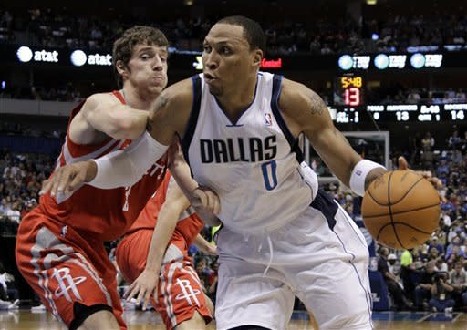 Dallas Mavericks' Shawn Marion (0) positions against Houston Rockets' Goran Dragic, left, of Slovenia, in the first half of an NBA basketball game on Wednesday, April 18, 2012, in Dallas. (AP Photo/Tony Gutierrez)