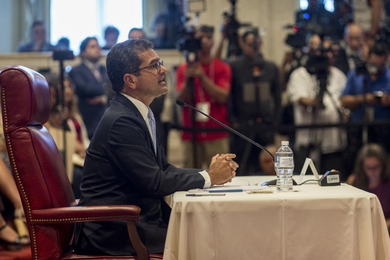 Proposed Secretary of State Pedro Pierluisi speaks during his confirmation hearing at the House of Representatives, in San Juan, Puerto Rico, Friday, August 2, 2019. As Gov. Ricardo Rossello is expected to leave office in a few hours, the Puerto Rican House of Representatives is expected to vote on Pierluisi's confirmation Friday afternoon. If he is rejected, Justice Secretary Wanda Vazquez automatically becomes governor as the next in the order of succession, even though she has said she would unwillingly accept the job. (AP Photo/Dennis M. Rivera Pichardo)