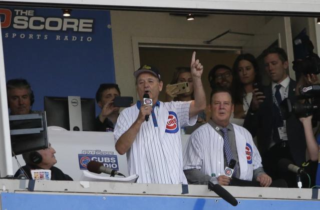 "<a class=""link rapid-noclick-resp"" href=""/ncaaf/players/253485/"" data-ylk=""slk:Bill Murray"">Bill Murray</a> sings ""Take Me Out to the Ball Game"" during the seventh inning stretch in Game 3 of the NLDS between the Cubs and Nationals Monday, Oct. 9, 2017, in Chicago. (AP Photo)"
