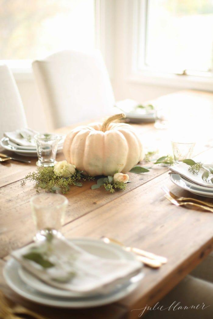 "<p>Place an artificial pumpkin on a bed of moss and leafy greens for a simple centerpiece that you can re-use for future holidays.</p><p><em><a href=""https://julieblanner.com/easy-thanksgiving-centerpiece/"" rel=""nofollow noopener"" target=""_blank"" data-ylk=""slk:Get the tutorial from Julie Blanner »"" class=""link rapid-noclick-resp"">Get the tutorial from Julie Blanner »</a></em></p>"