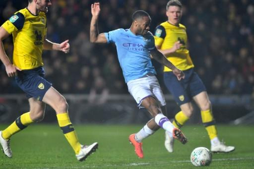 Raheem Sterling scored twice as Manchester City beat Oxford 3-1 to reach the League Cup semi-finals