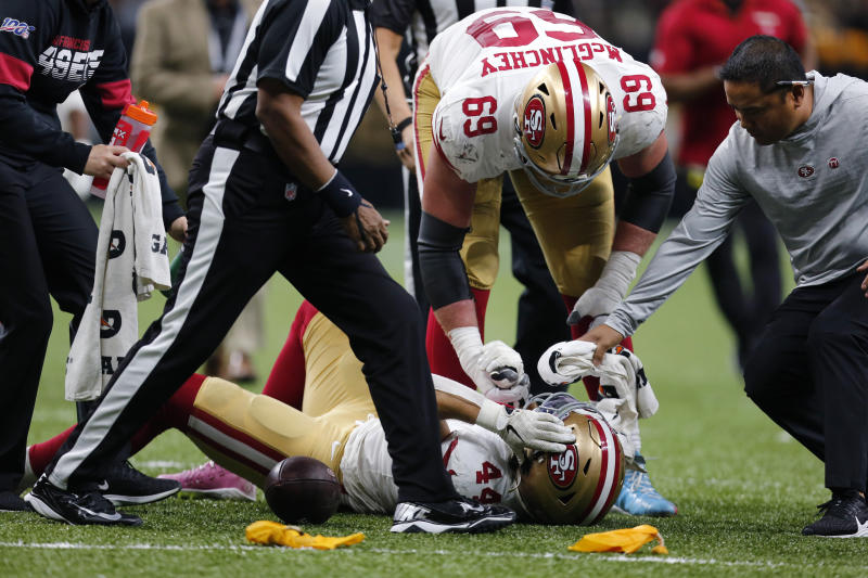 San Francisco 49ers offensive tackle Mike McGlinchey (69) tends to fullback Kyle Juszczyk (44) after being hit in the second half an NFL football game against the New Orleans Saints in New Orleans, Sunday, Dec. 8, 2019. The 49ers won 48-46. (AP Photo/Brett Duke)