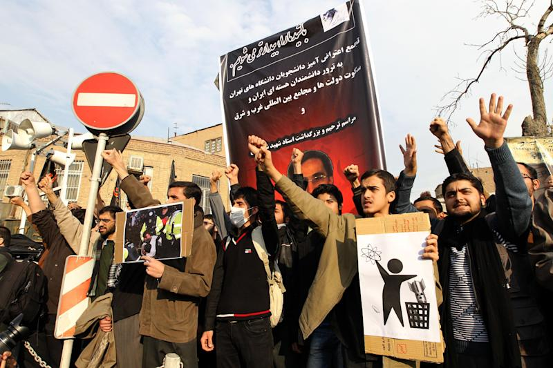 Dozens of basijis, members of Iran's hardline Islamist militia, demonstrate in front of Britain's embassy in downtown Tehran on Dec. 12, 2010 over the killing of a top Iranian nuclear scientist last month. Iranian leaders have pointed an accusing finger at the British intelligence service the MI6 as well as US and Israeli intelligence over the assassination. (Photo: Atta Kenare/AFP/Getty Images)