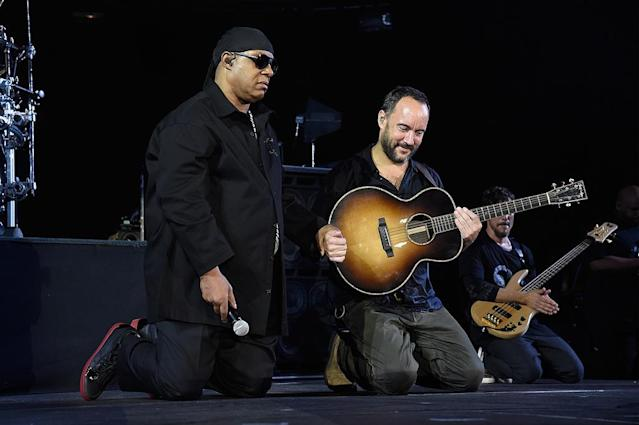 """<p>So did Stevie Wonder and Dave Matthews at the same show, <em>A Concert for Charlottesville</em>. """"I take a knee for America,"""" said Wonder, holding Matthews's hand, """"and two knees in prayer for our world."""" (Photo: Kevin Mazur/Getty Images) </p>"""