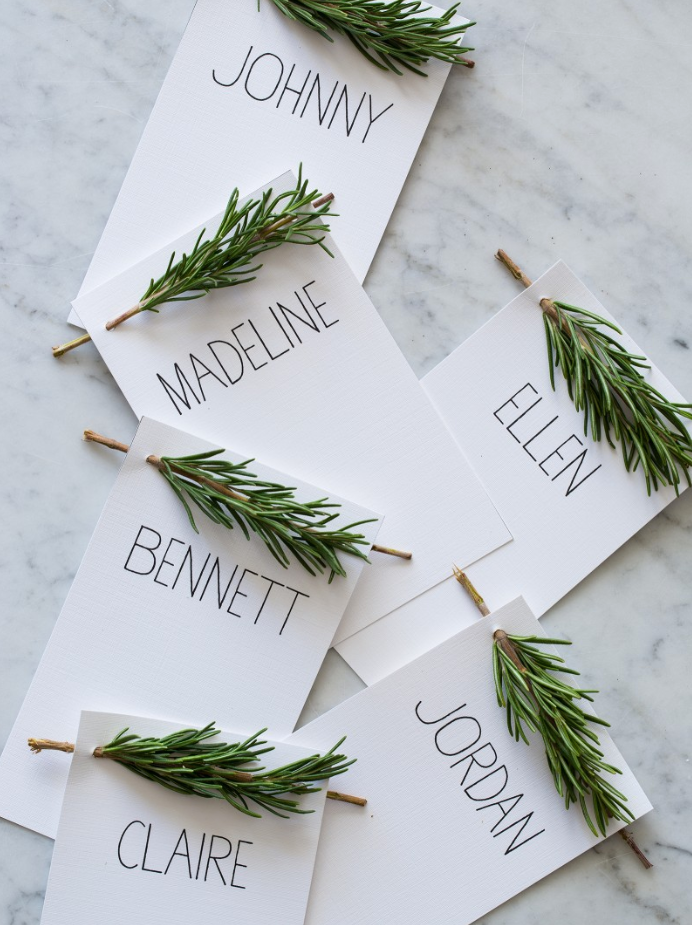 "<p>These sweet little place cards prove you don't have to spend a ton of time or energy on your table decor to make it truly shine. A simple sprig of rosemary is really all it takes. </p><p><strong>Get the tutorial at <a href=""https://www.spoonforkbacon.com/rosemary-sprig-place-cards/"" rel=""nofollow noopener"" target=""_blank"" data-ylk=""slk:Spoon Fork Bacon"" class=""link rapid-noclick-resp"">Spoon Fork Bacon</a>. </strong></p><p><strong><strong><a class=""link rapid-noclick-resp"" href=""https://www.amazon.com/Inches-Letter-Sheets-Smooth-216gsm/dp/B00RU6IGAS?tag=syn-yahoo-20&ascsubtag=%5Bartid%7C10050.g.1538%5Bsrc%7Cyahoo-us"" rel=""nofollow noopener"" target=""_blank"" data-ylk=""slk:SHOP WHITE CARD STOCK"">SHOP WHITE CARD STOCK</a></strong><br></strong></p>"