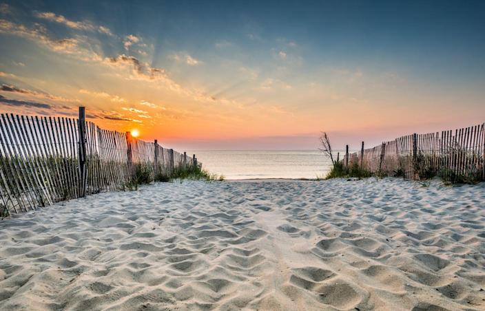 <p>You can almost feel the sensation of sand between your toes looking at this beach in Delaware leading to the Atlantic Ocean. </p>