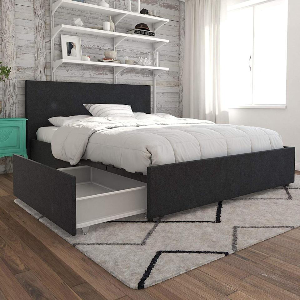 """You can use the drawers on the sides for your pajamas, off-season clothes or extra blankets, because your rental's sorry excuse for a closet just isn't cutting it.<br /><br /><strong>Promising review:</strong>""""The bed was easy to put together. I needed help moving the box but once opened one person can do this. I bought this for the look and the storage.<strong>The four drawers really do work very well, they roll out for easy access. They do hold a lot, much more than I expected.</strong>You really do not see the draws. I bought a pillow top mattress to go with this, as I wanted a higher bed. Another unexpected plus is that I can use my king-size sheets, they just tuck under the mattress. I'm very pleased with this bed."""" —<a href=""""https://amzn.to/3a9Z72T"""" target=""""_blank"""" rel=""""nofollow noopener noreferrer"""" data-skimlinks-tracking=""""5902331"""" data-vars-affiliate=""""Amazon"""" data-vars-href=""""https://www.amazon.com/gp/customer-reviews/R339WSIT9ET4G7?tag=bfmal-20&ascsubtag=5902331%2C7%2C37%2Cmobile_web%2C0%2C0%2C16540705"""" data-vars-keywords=""""cleaning"""" data-vars-link-id=""""16540705"""" data-vars-price="""""""" data-vars-product-id=""""20969626"""" data-vars-product-img="""""""" data-vars-product-title="""""""" data-vars-retailers=""""Amazon"""">ellen</a><br /><br /><strong>Get it from Novogratz on Amazon for<a href=""""https://amzn.to/3wX4lc3"""" target=""""_blank"""" rel=""""nofollow noopener noreferrer"""" data-skimlinks-tracking=""""5902331"""" data-vars-affiliate=""""Amazon"""" data-vars-asin=""""B07G5N1DKQ"""" data-vars-href=""""https://www.amazon.com/dp/B07G5N1DKQ?tag=bfmal-20&ascsubtag=5902331%2C7%2C37%2Cmobile_web%2C0%2C0%2C16540699"""" data-vars-keywords=""""cleaning"""" data-vars-link-id=""""16540699"""" data-vars-price="""""""" data-vars-product-id=""""18071901"""" data-vars-product-img=""""https://m.media-amazon.com/images/I/51OdExVGzML.jpg"""" data-vars-product-title=""""Novogratz Kelly Upholstered Storage Platform Bed - Queen (Dark Gray Linen)"""" data-vars-retailers=""""Amazon"""">$445.46+</a>(available in five colors and four sizes).</strong>"""