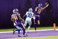 Minnesota Vikings wide receiver Adam Thielen (19) catches a 2-yard touchdown pass ahead of Dallas Cowboys cornerback Anthony Brown (30) during the second half of an NFL football game, Sunday, Nov. 22, 2020, in Minneapolis. (AP Photo/Jim Mone)