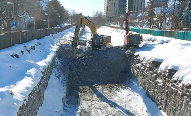 A file photo of SNC-Lavalin widening the rock cut of the existing Trillium Line from Bayview Station to Beech Street. Council voted 16 to 8 against a move to add discussion of the Trillium Line construction delays to Wednesday's council agenda.  (City of Ottawa - image credit)