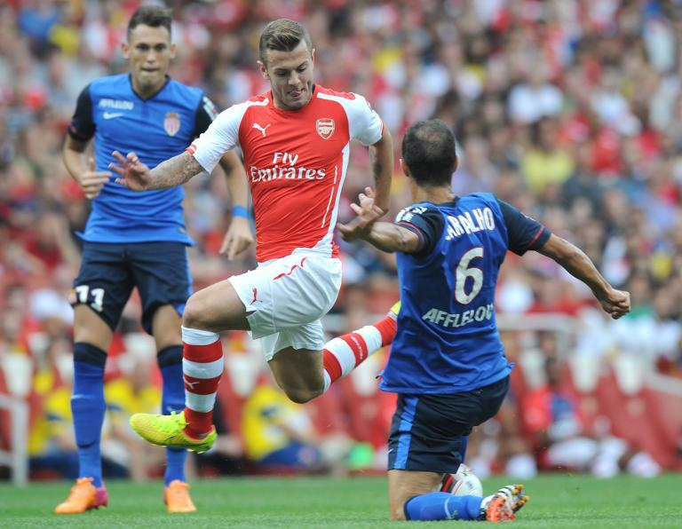 Arsenal's Jack Wilshire (C) is tackled by Monaco's Ricardo Carvalho during the Emirates Cup match at Emirates Stadium on August 3, 2014