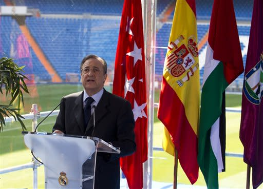 Real Madrid's club president Florentino Perez makes a speech during a presentation at the Bernabeu stadium in Madrid Thursday March 22, 2012. Real Madrid will open a Sports oriented theme park combining soccer and tourism in The United Arab Emirates in 2015 which will include sports facilities, hotels, apartments, bungalows and a beach resort. (AP Photo/Paul White)