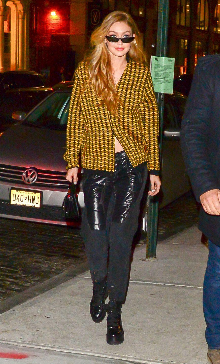 <p>In a mustard yellow chevron shirt, leather padded pants, platform boots, and slim cat eye sunglasses while out in NYC.</p>