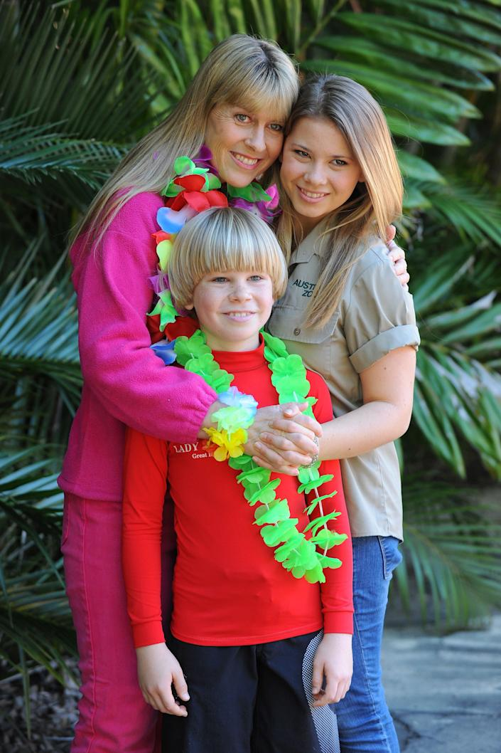 In this handout photo provided by Australia Zoo, Bindi Irwin celebrates her 15th birthday with her mother Terri Irwin and brother Robert Irwin, on July 24, 2013 in Beerwah, Australia. (Photo by Ben Beaden/Australia Zoo via Getty Images)