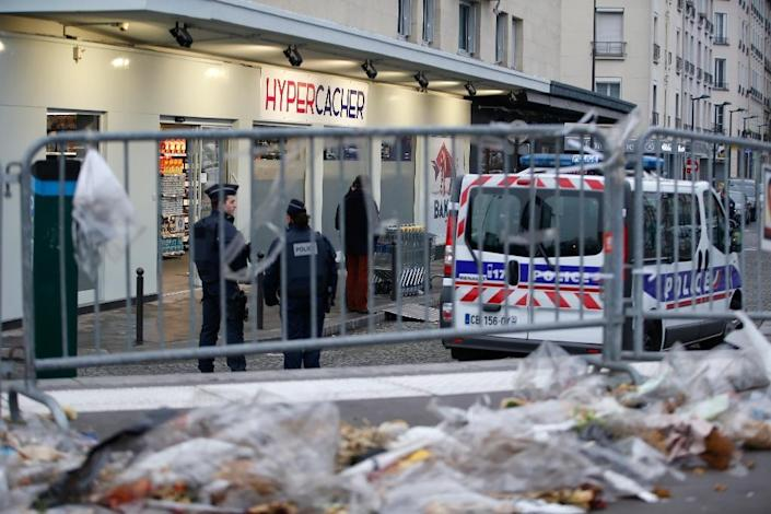 Police guard the Hyper Cacher Kosher supermarket in Paris that became the site of a bloody hostage drama during a jihadist attack in January 2015 (AFP Photo/Kenzo Tribouillard)