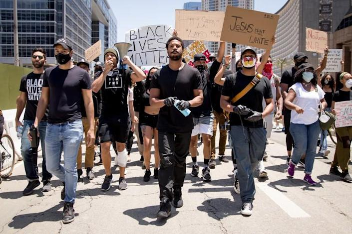 """Protesters, including Michael B. Jordan and Kendrick Sampson, march in support of Black Lives Matter in Beverly Hills in June. <span class=""""copyright"""">(Rich Fury/Getty Images)</span>"""