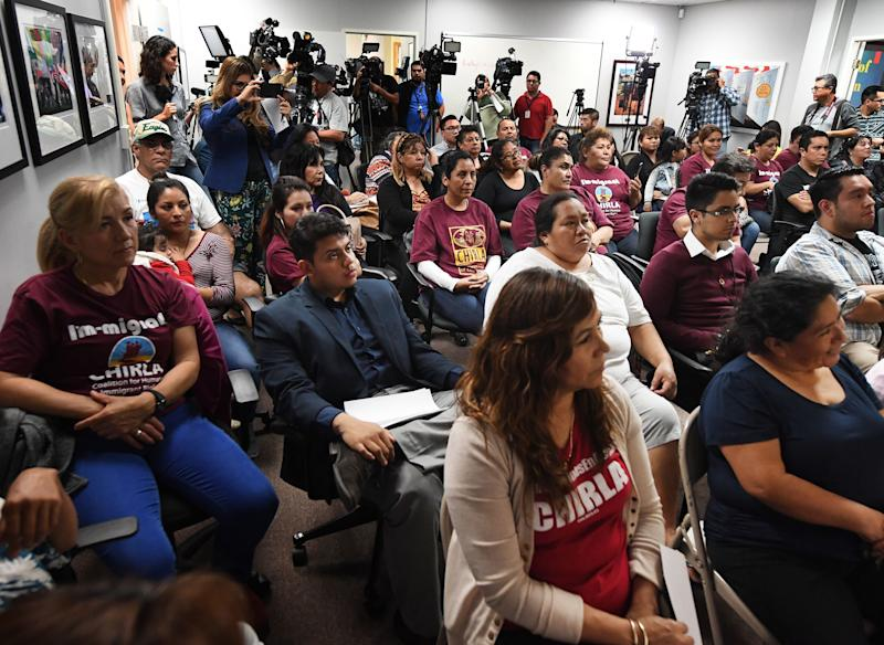 DACA recipients and supporters watch President Donald Trump during a State of the Union party at the Coalition for Humane Immigrant Rights and the California Dream Network offices in Los Angeles, Jan. 30, 2018. (MARK RALSTON via Getty Images)