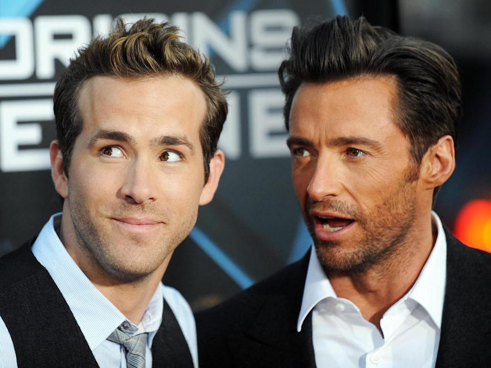 Ryan Reynolds (R) and Hugh Jackman arrive for the Los Angeles industry screening of 'X-Men Origins-Wolverine' at Grauman's Chinese Theater in Hollywood, California, on April 28, 2009.