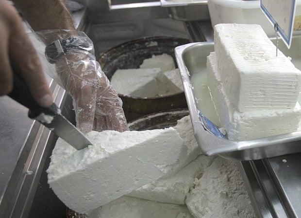 The failed business venture involved a plan to import, process and distribute 25 tonnes of feta cheese from Greece. (Aris Messinis/AFP via Getty Images - image credit)
