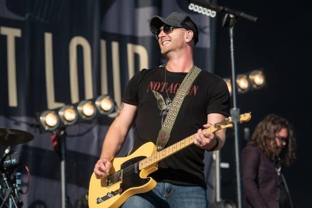 St. Catharines, Ont., singer-songwriter Tim Hicks, pictured here at the Boots and Hearts Music Festival in 2019. (Whitney South - image credit)
