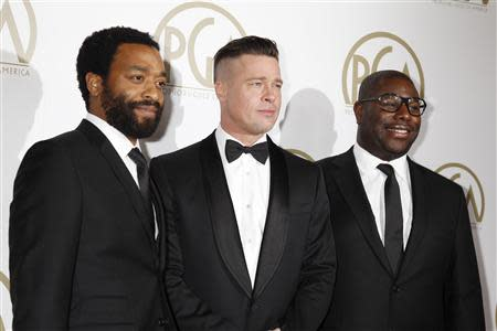 """Brad Pitt and Steve McQueen, producers of the film """"12 Years A Slave"""", along with cast Chiwetel Ejiofor, arrive at the 25th Annual Producers Guild of America Awards in Beverly Hills"""