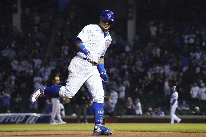 Chicago Cubs' Javier Baez runs the bases after hitting a home run against the Milwaukee Brewers during the fourth inning of a baseball game, Monday, April 5, 2021, in Chicago. (AP Photo/David Banks)