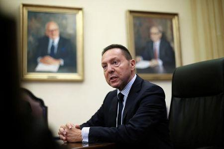 Governor of the Central Bank of Greece Stournaras speaks during an interview with Reuters at the bank's headquarters in Athens