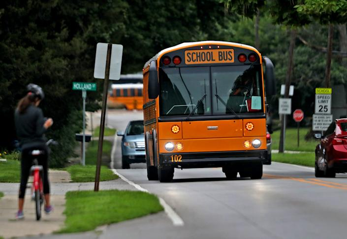School buses are out in force in Noblesville, Ind., for the first day of the 2020/2021 school year Aug. 4.